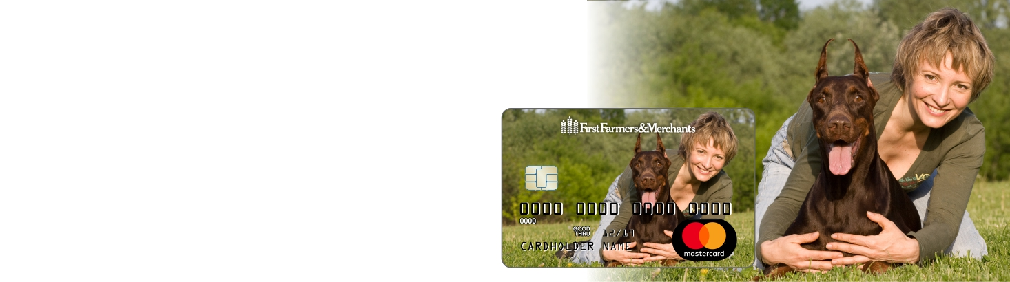 woman nest to her doberman with an inset photo of a debit card with the same photo on it.